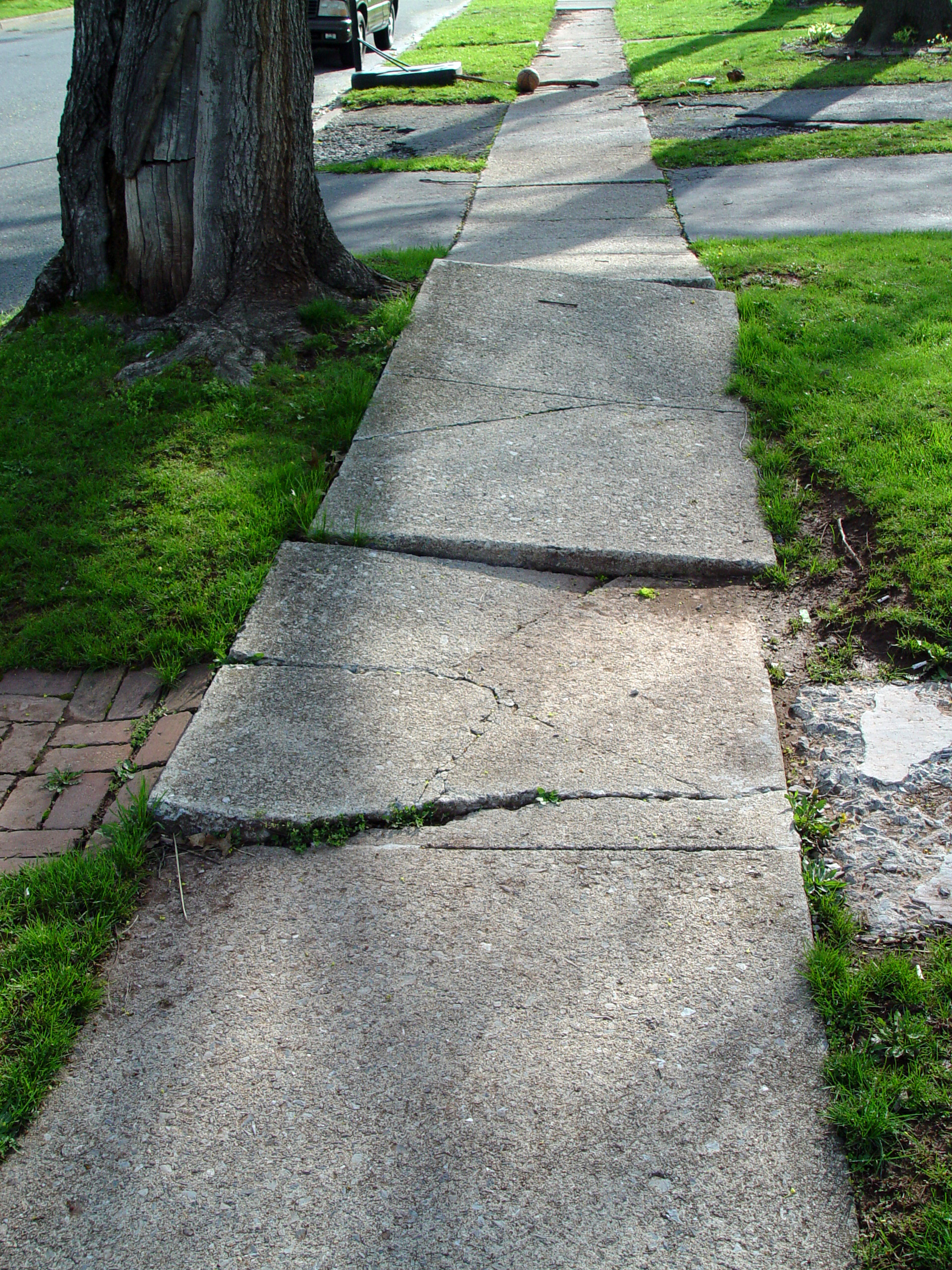 Sidewalk Trip and Fall . . . Who is at Fault? Who Pays?